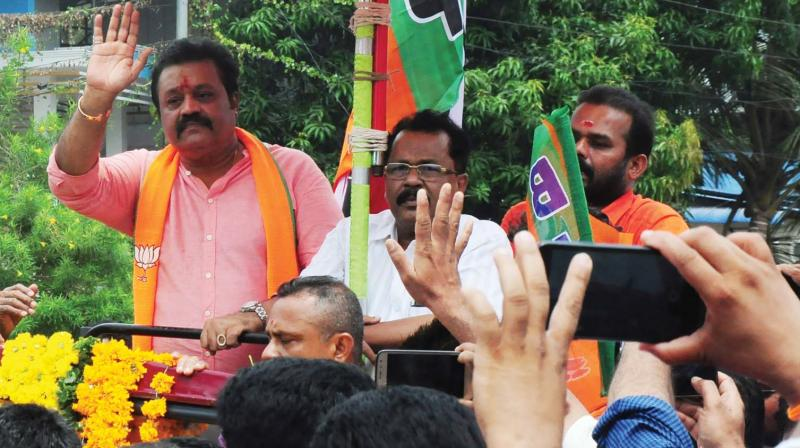NDA's Thrissur candidate Suresh Gopi and BJP state president P. S. Sreedharan Pillai during the election  campaign in Thrissur on Thursday (Photo: ANUP K. VENU)