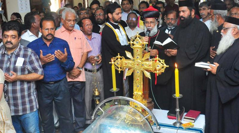 Cardinal Baselios Cleemis offers prayers as the body of Dr D. Babu Paul, former Additional Chief Secretary, was kept for public homage at his residence in Thiruvananthapuram on Saturday	(Photo: A.V. MUZAFAR)