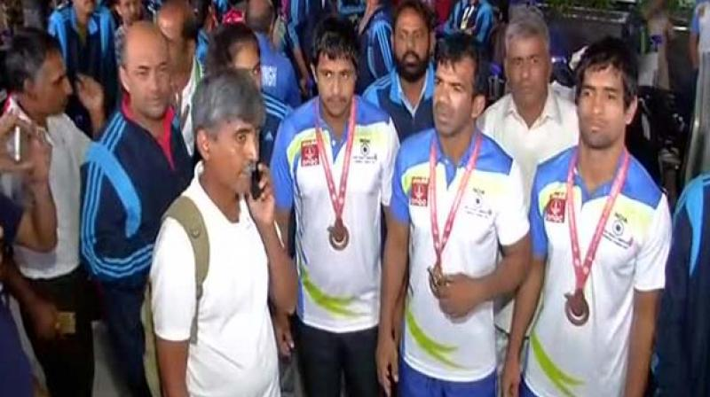 The Indian Deaflympics team protest at the Delhi Airport. (Photo: ANI/Twitter)