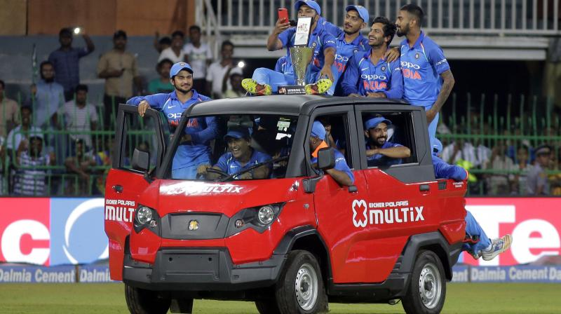 The former India skipper gave fans a nostalgic moment as he took Virat Kohli and co for a ride in Jasprit Bumrah's man-of-the-match awarded car. (Photo: AP)