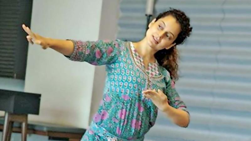 "In this picture posted on Instagram, 'Team Kangana Ranaut' says the actress is practising Bharatanatyam for Jayalalithaa's biopic, 'Thalaivi'. ""Prepping to perfection"", said the Instagram post, warmly complimenting the star for her serious preparations for the film. Kangana is ""personally not on social media"", according to the Team."