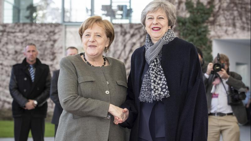 German Chancellor Angela Merkel, left, welcomes British Prime Minister Theresa May prior to a meeting at the chancellery in Berlin. (Photo:AP)