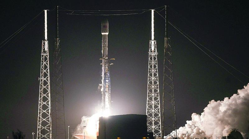 SpaceX's 16-foot-tall (4.9 meter) Crew Dragon capsule, atop a Falcon 9 rocket, lifted off from Florida's Kennedy Space Center at 2:49 a.m. (0749 GMT), carrying a test dummy nicknamed Ripley.