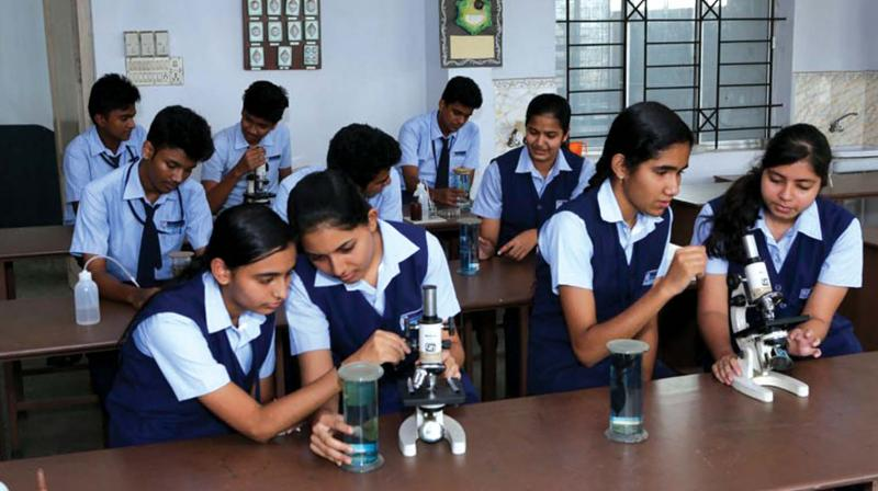 Students of Rajagiri HSS, Kalamassery at their lab (from website)
