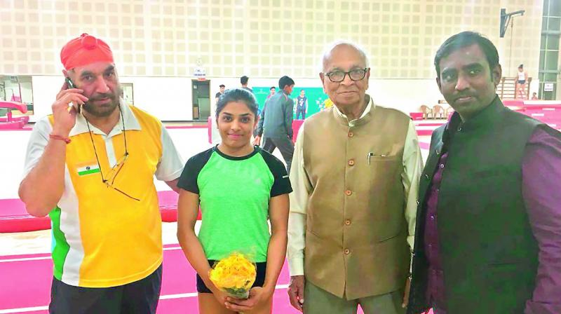 Gymnastics World Cup bronze medallist Budda Aruna Reddy (second from left) is flanked by Gymnastics Federation of India chief coach Gurdial Singh Bawa (left), Olympic Association of Telangana president K. Ranga Rao (second from right) and Gymnastics Association of Telangana secretary K. Maheswar (right) at the Indira Gandhi Indoor Stadium in New Delhi on Wednesday evening.