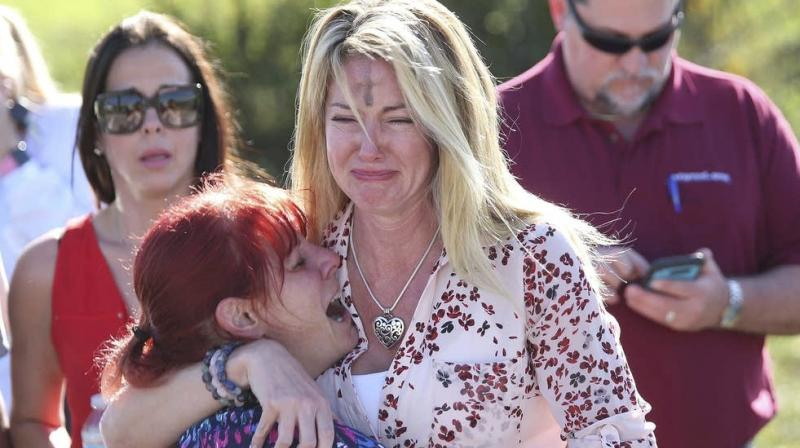 Parents wait for news after a reports of a shooting at Marjory Stoneman Douglas High School in Parkland. (Photo: AP)