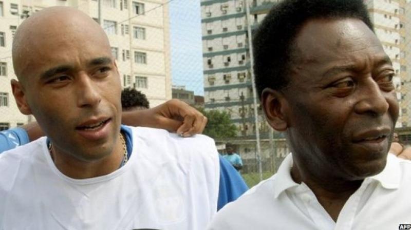 Edinho (L) with his legendary father Pele. (Photo: AFP)