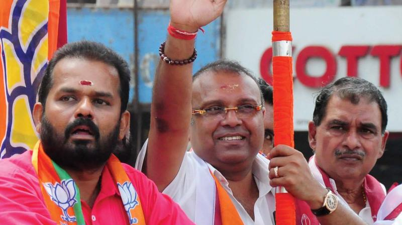 NDA's Thrissur candidate Tushar Vellappally and BJP district president A. Nagesh during the election campaign at Thrissur on Friday.  (Anup K. Venu)