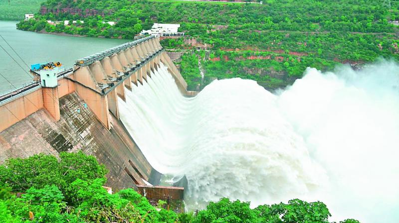 Telangana State and Andhra Pradesh have decided to jointly release water to the farmers in both the states by lifting the Nagarjunasagar canal gates. On Sunday, Telangana state education minister G. Jagadish Reddy and AP irrigation minister Anil Kumar Yadav would jointly lift the left and right gates of Nagarjunasagar dam to release the water. Later, Mr Reddy will release water through the LLC and AMR canals. (Photo: DC)
