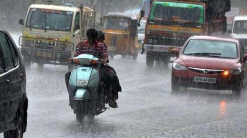 The gusty winds accompanied by heavy rain which tore through many places in the morning hours made it difficult to see the road. (Representational image)