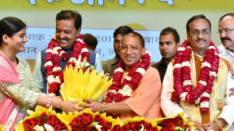 Union minister of state for health and family welfare and Apna Dal leader Anupriya Patel greets BJP's Yogi Adityanath (C) elected leader of the BJP Legislature Party, K.P. Muriya (L Deputy CM) and Dinesh Sharma (R Deputy CM) in Lucknow on Saturday. (Photo: PTI)