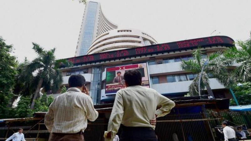 Investors at BSE check changing share prices. (Photo: PTI)