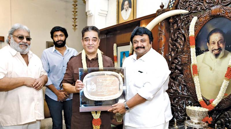 Kamal presented with a plaque