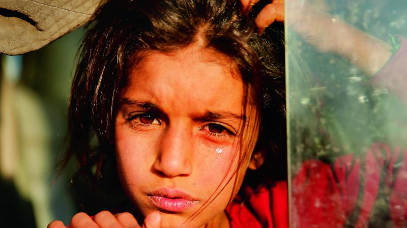 A Syrian girl displaced by the Turkish military operation in northeastern Syria, is seen weeping. (Photo: AP)