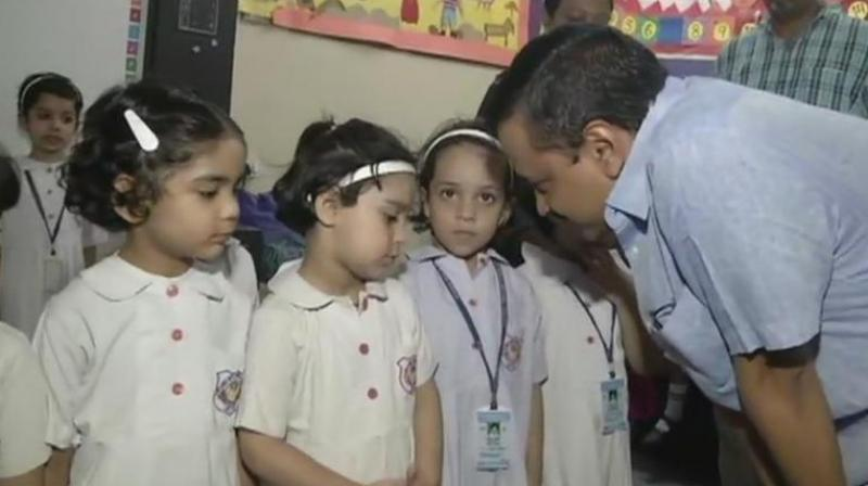 Delhi Chief Minister Arvind Kejriwal and his deputy Manish Sisodia interacted with students and teachers there. (Photo: Twitter | ANI)