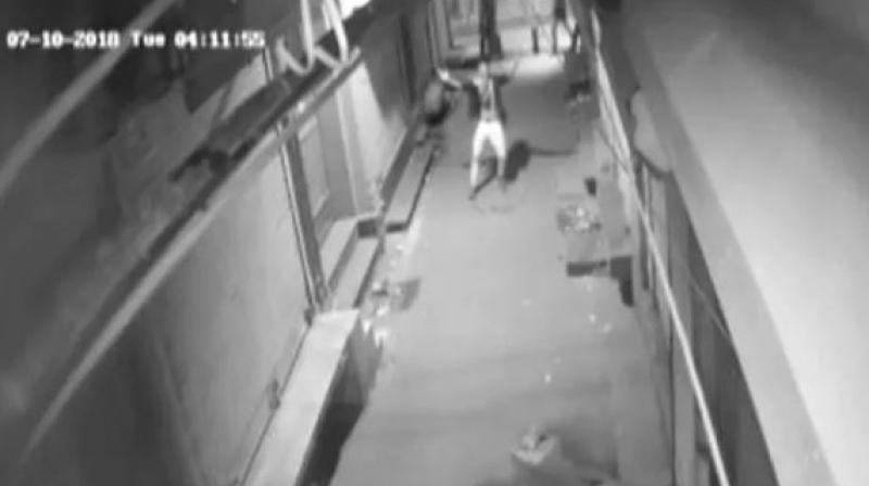 A thief captured on CCTV dancing in the middle of night in a deserted lane in Delhi. (Photo: Screengrab | ANI)