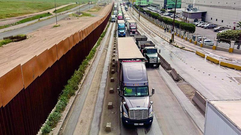 An April 4 picture shows cargo trucks lined up to cross to the US near the US-Mexico border at Otay Mesa crossing port in Tijuana, Baja California state, Mexico. ( Photo: AFP)