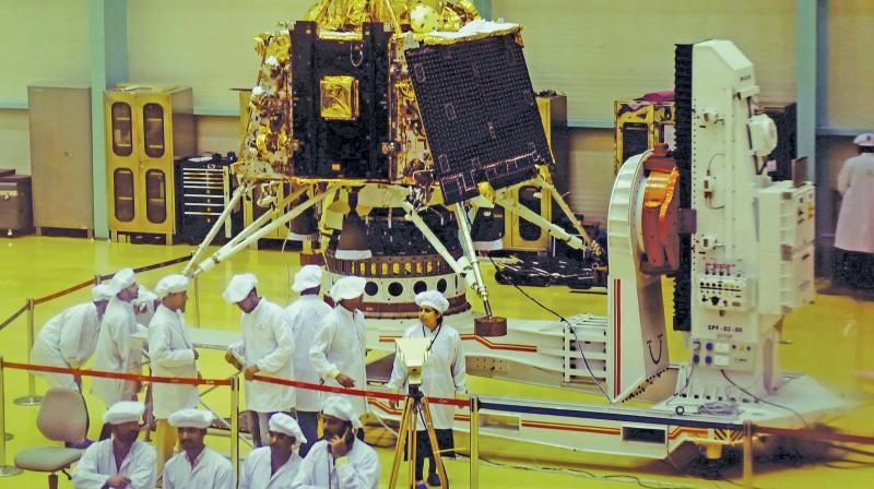 Isro personnel work on the orbiter vehicle of Chandrayaan-2, India's first moon lander and rover mission planned and developed by Isro at Isro Satellite Integration and test establishment (ISITE), in Bengaluru, on Wednesday. 	— PTI
