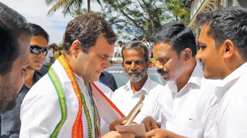 Gudalur residents submit a memorandum to Rahul Gandhi during his recent visit to Wayanad. — DC