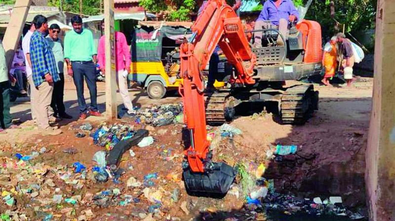 Canals being desilted  in Nellore on Thursday. — DC