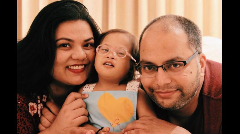 For Kavita (left) and Himanshu (right), different is beautiful. They adopted a baby (centre) with Down Syndrome. (Photo: Instagram/ extrachromieveda)