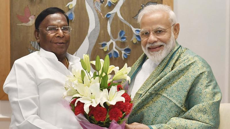 Prime Minister Narendra Modi being greeted by Puducherry Chief Minister V. Narayanasamy during a meeting in New Delhi on Saturday. 	—PTI
