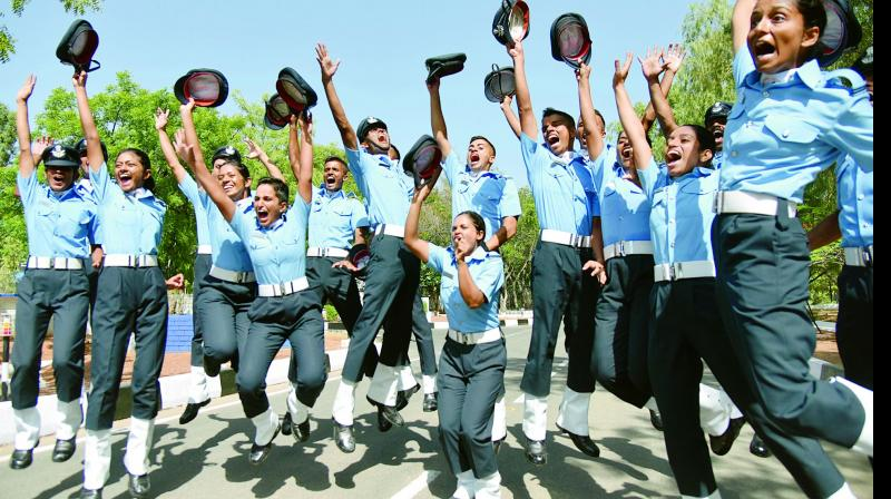 Flight cadets belonging to various branches of Indian Air Force Academy celebrate after the successful completion of pre-commissioning training at Dundigal in Hyderabad on Saturday. — S. Surender Reddy