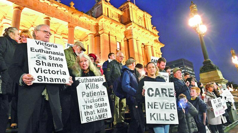 Pro-life demonstrators gather outside the Victorian State Parliament, opposing the voluntary Euthanasia laws at Melbourne on Tuesday. — AP