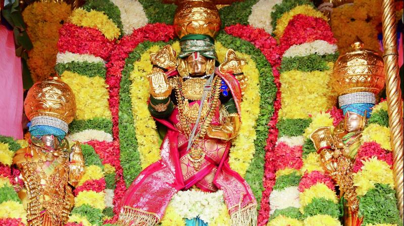 Porcessional deities of Lord Prasanna Venkateswara Swamy and his consorts taken out in a chariot in Tirupati on Thursday. — DC