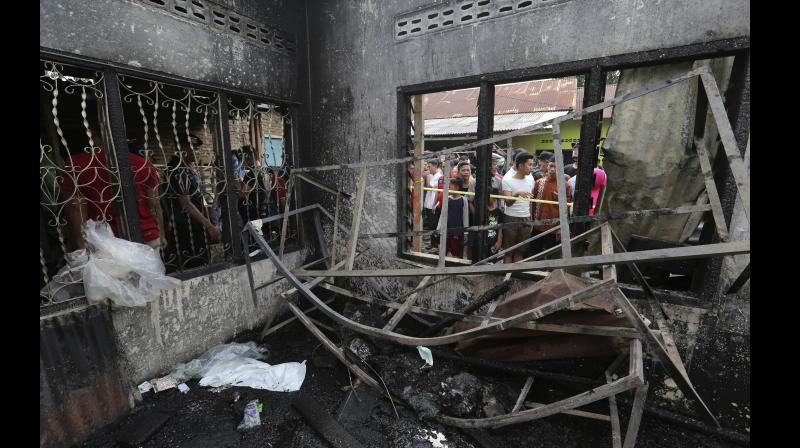 At least two dozen people were killed when a fire ripped through a matchstick warehouse in Indonesia on Friday, authorities said. (Photo: AP)