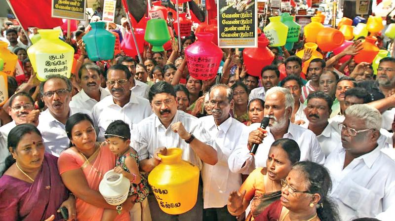DMP MP Dayanidhi Maran holds a protest against the state government's way of tackling the water crisis, at Villivakam in Sidco Nagar on Saturday. 	—DC