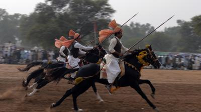 Festooned with garlands and colourful bridles, turbaned riders mounted on horseback in full gallop lower their lances at tiny wooden blocks as they practice the centuries-old tradition of tent-pegging in Pakistan. (Photo: AFP)