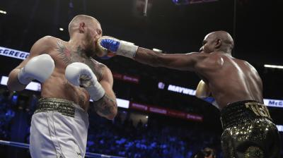 Conor McGregor ran out of steam in the end, as Floyd Mayweather rushed in, to extend his career record to 50-0. (Photo: AP)