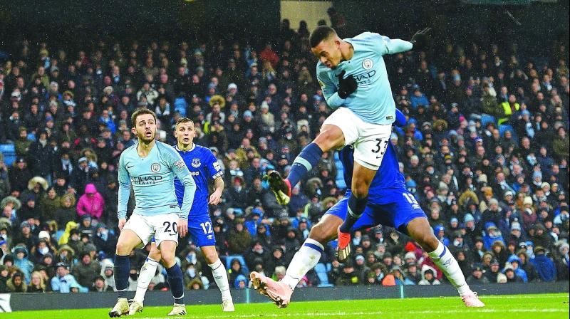 Manchester City's Gabriel Jesus scores against Everton in their EPL match in Manchester on Saturday. 	— AFP