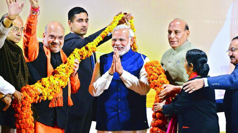 Prime Minister Narendra Modi is being felicitated by senior party leaders — finance minister Arun Jaitley, party chief Amit Shah, home minister Rajnath Singh and external affairs minister Sushma Swaraj — at the party headquarters in New Delhi on Monday after the party emerged victorious in Gujarat and Himachal Pradesh polls. (Photo: AP)