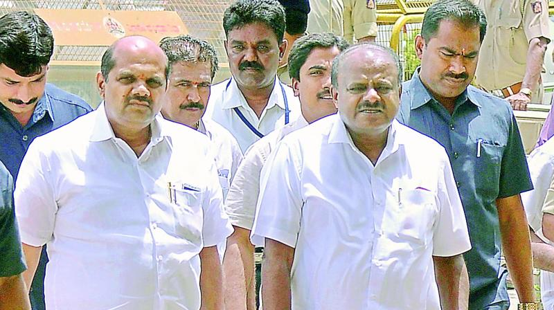 Karnataka Chief Minister H D Kumaraswamy arrives at Vidhana Soudha in Bengaluru on Thursday.  (PTI)