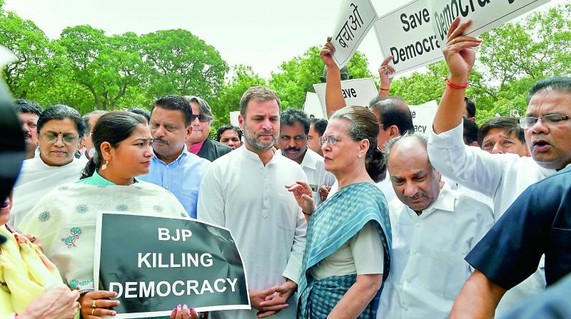 Congress Parliamentary Party Chairperson Sonia Gandhi with Rahul Gandhi and other party MPs during their 'Save Democracy' protest over Karnataka and Goa issues, in front of the Mahatma Gandhi statue in Parliament complex, New Delhi, on Thursday.  (PTI)