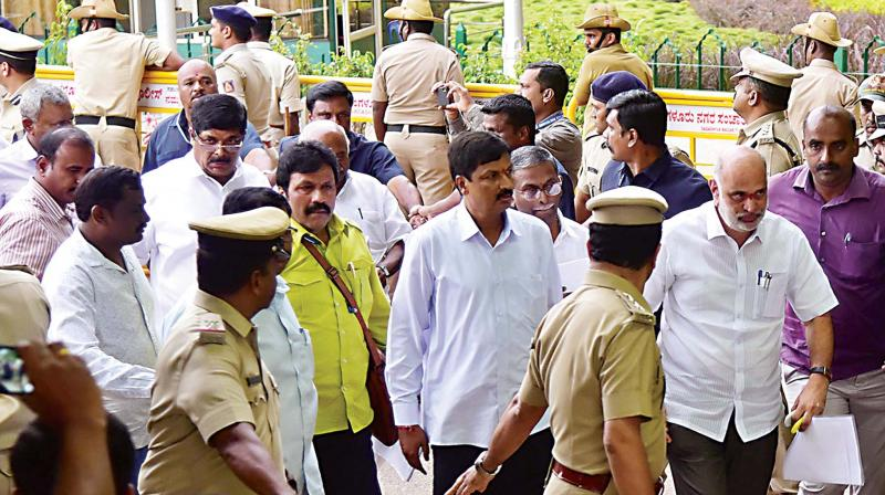 Rebel Congress and JD(S) MLAs arrive at Vidhana Soudha on Thursday.