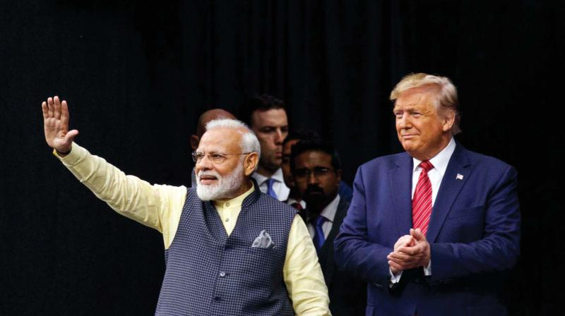 Prime Minister Narendra Modi and US President Donald Trump join hands at the 'Howdy, Modi!' event at NRG Stadium in Houston, Texas, on Saturday. (Photo: AFP)