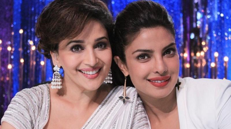 Madhuri Dixit-Nene with Priyanka Chopra on a TV show.