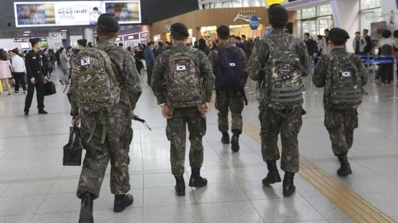 A watchdog group says South Korea's army is hunting down and prosecuting gay servicemen after a video of two male soldiers having sex was posted on the internet earlier this year, stoking fear in an already persecuted minority group. (Photo: AP)