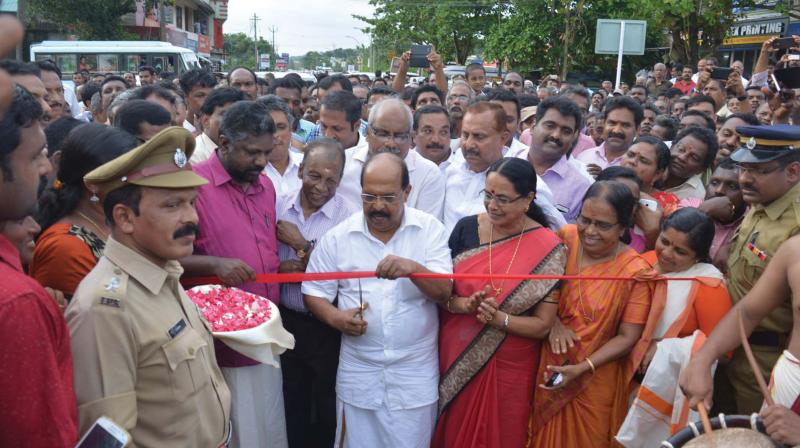 PWD Minister G. Sudhakaran inaugurates the bridge in Enath. Aisha Potti, MLA, looks on.