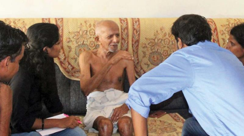 Researchers interviewing 88-year old Beeran Kutty, a native of  Elampulassery village as part of data collection