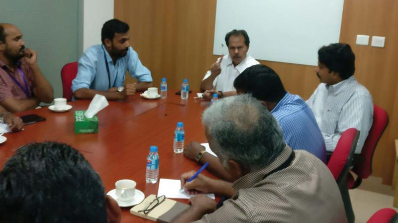 P.T. Thomas, MLA, presides over the meet held as part of forming the Infopark Forum.
