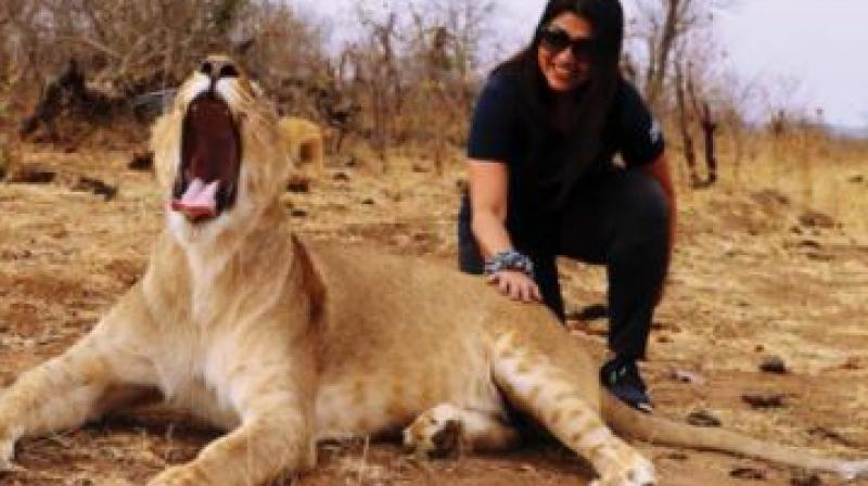 Geetha Deo with a lioness at Victoria Falls in Zambia-Zimbabwe border