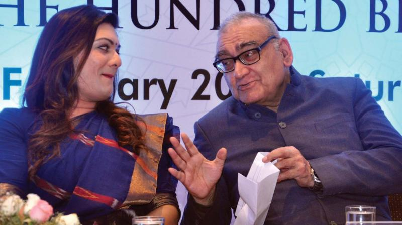 Former Supreme Court Judge Justice Markandeya Katju chats with All India Mahila Congress general secretary Apsara Reddy during the release of the book titled Quran Akamporul in Kochi on Saturday. 	 (SUNOJ NINAN MATHEW.)
