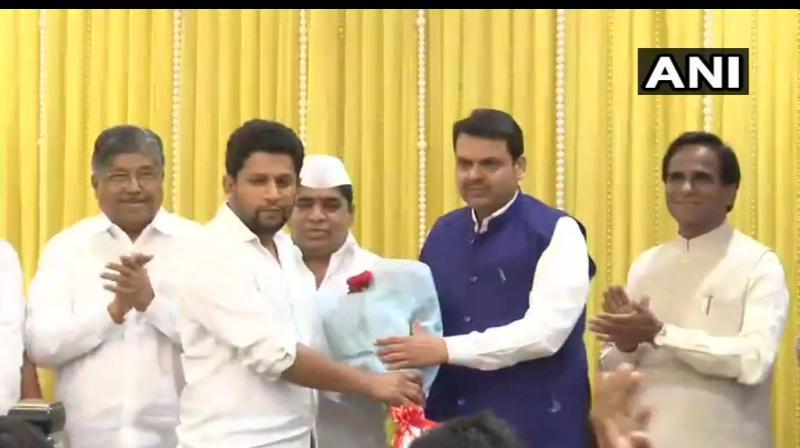 Maharashtra's Leader of Opposition Radhakrishna Vikhe Patil's son Sujay (pic) joined BJP on Tuesday. (Photo: TwitterANI)
