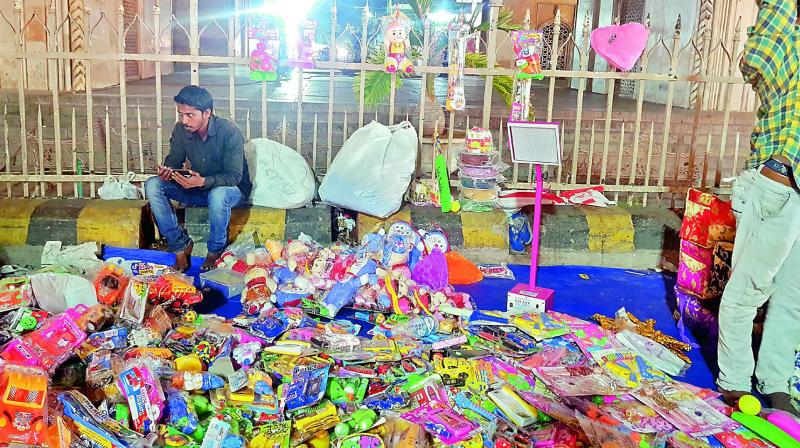 Hawkers have grabbed buffer zone around Charminar and are using the railings to display their items. (Photo: DC)
