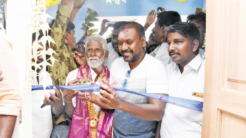 Actor Raghava Lawrence and Ganeshan at the housewarming ceremony on Tuesday.(Photo: DC)