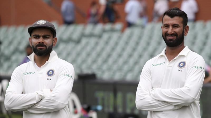 India captain Virat Kohli has maintained his top spot, Cheteshwar Pujara returned to top five while Jasprit Bumrah achieved a career-high ranking of 33 in the latest ICC Test rankings for batsmen and bowlers. (Photo: AP)